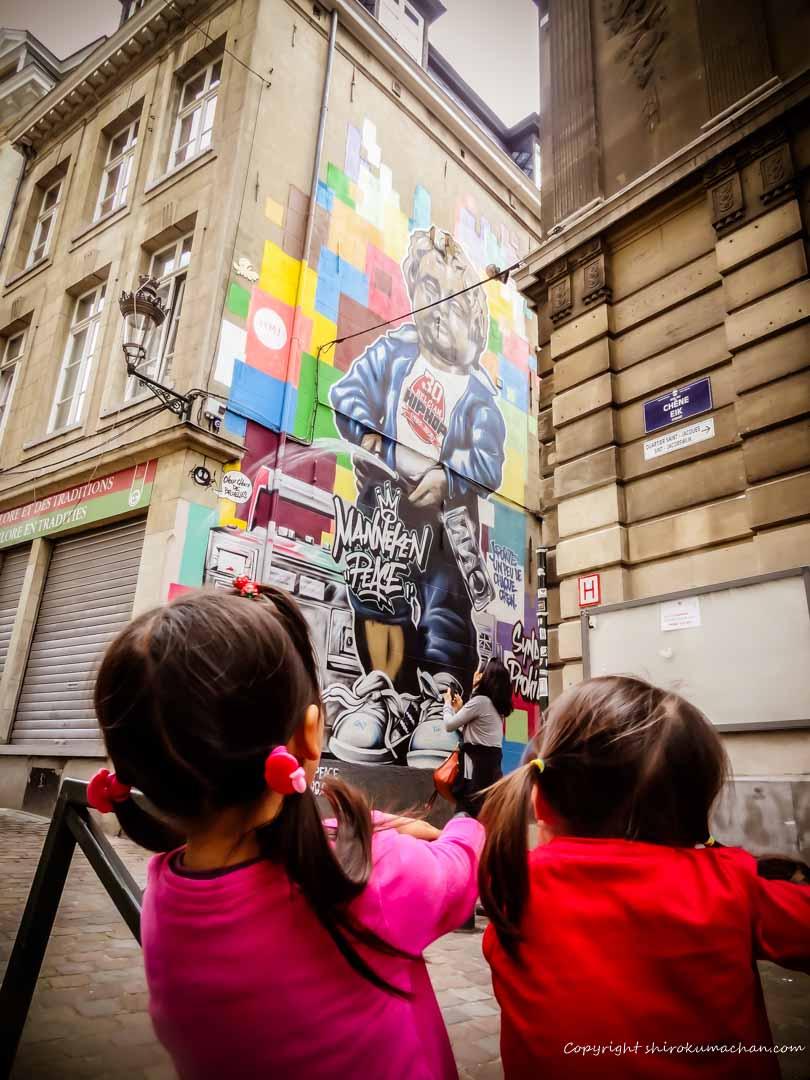 Manneken Pis Wall Paintings hang around in Brussels, Belgium
